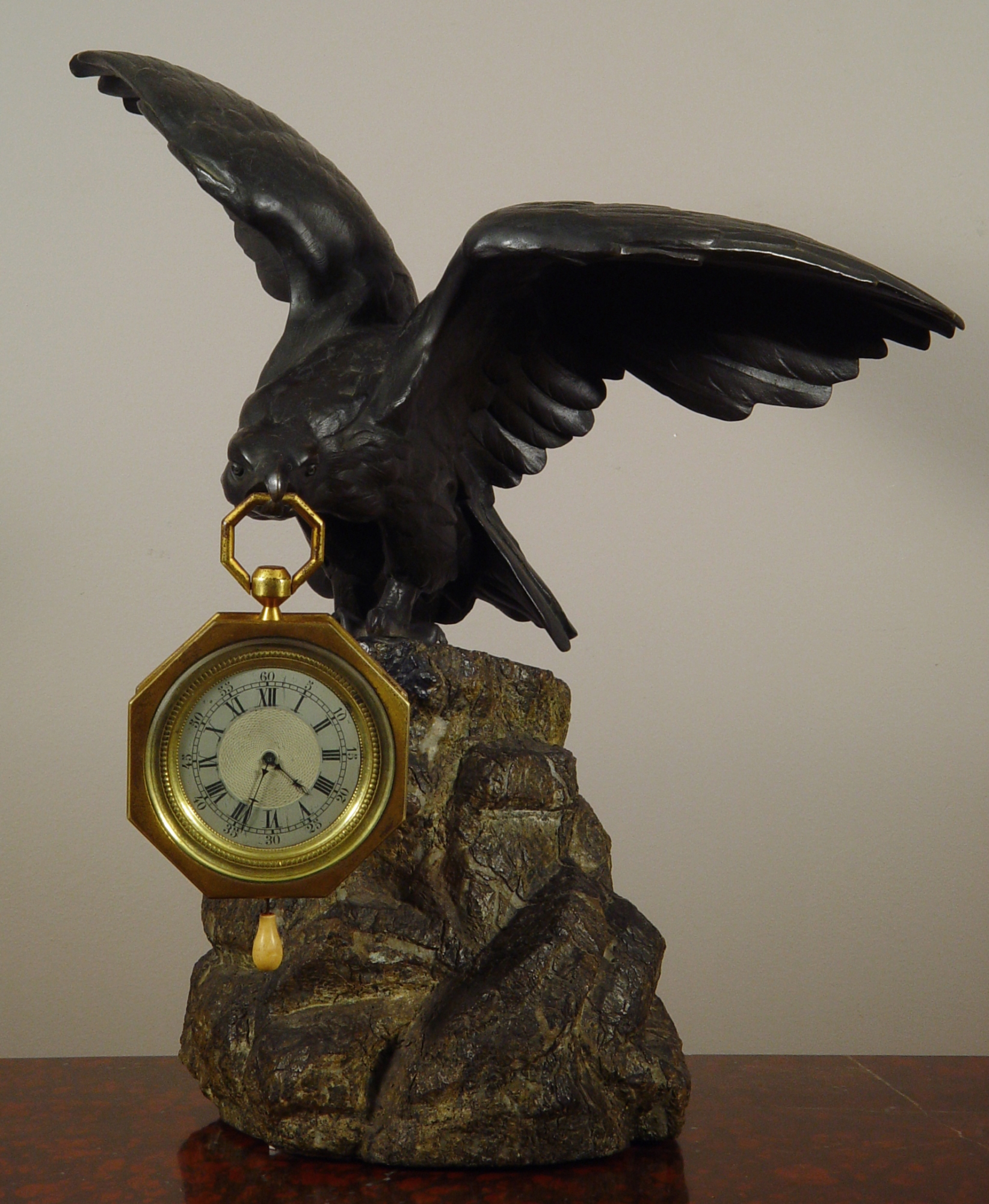 An Eagle Shaped Bronze Watch Stand And Clock Watch With