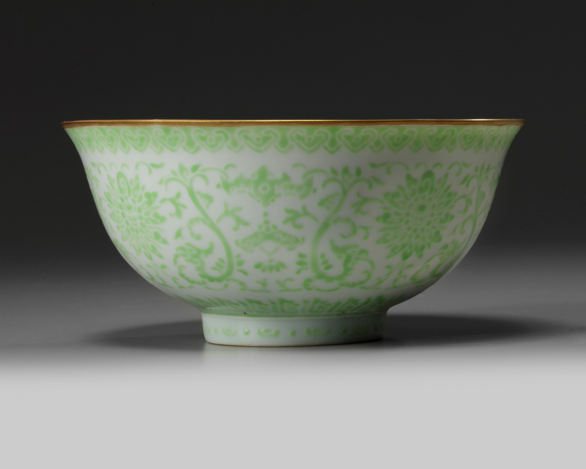 A Chinese Lime Green Enamelled Scrolling Lotus Bowl