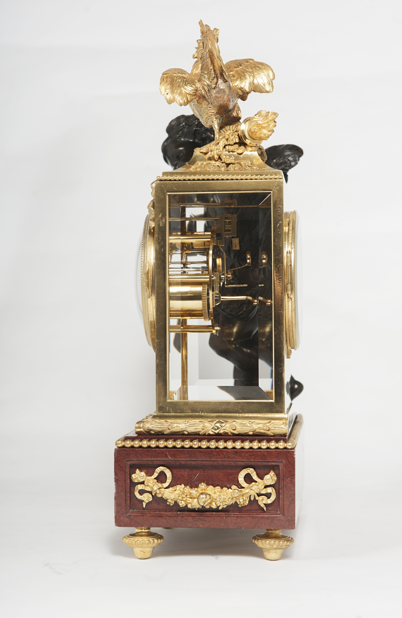 A Good 19th Century Decorative Three Piece Ormolu Clock
