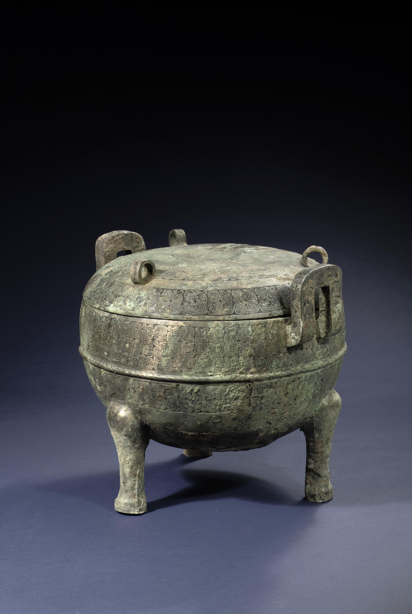 An archaic chinese bronze vessel ding shape spring and for Chinese art furniture