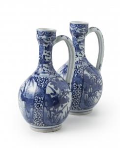 A pair of Arita wine jugs