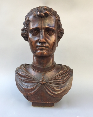 Wooden bust of a young man