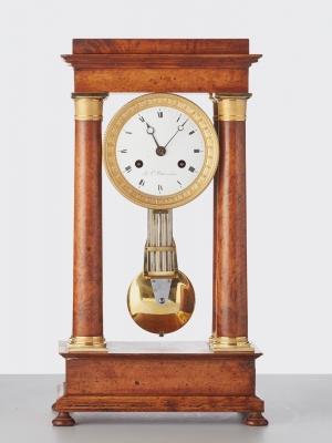 A French 'Empire' maple and gilt 4-column clock, circa 1830