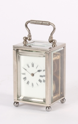 An attractive miniature French nickel plated carriage timepiece circa 1925
