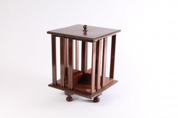 A small English brass inlaid mahogany revolving bookcase, circa 1880.