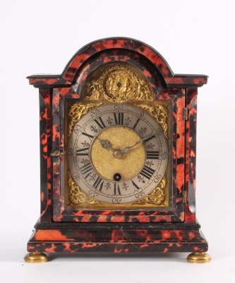 An attractive small South German red tortoishell bracket timepiece with automaton, circa 1740.