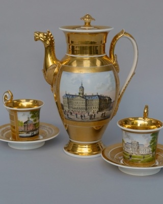 Empire coffee pot and two cups and saucers with views of Amsterdam, Haarlem and Rotterdam
