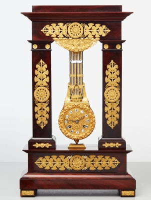 A rare French mahogany and bronze oscillating mantel clock, circa 1830