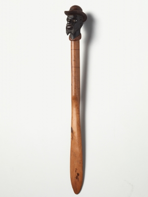 An American coloured wood 'dandy face' letter opener, circa 1880