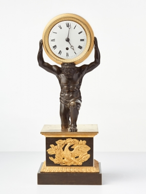 "An English Regency ""Atlas"" drum mantel clock by Baetens, circa 1830."