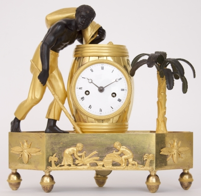 A French Empire ormolu and patinated bronze 'au bon sauvage' mantel clock, circa 1800.