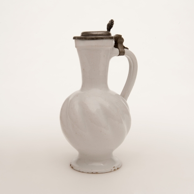 A Twisted Jug with Pewter Lid in White Dutch Delftware