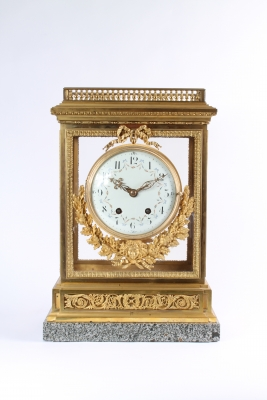 An impressive French Louis XVI-style gilt bronze and marble mantel clock