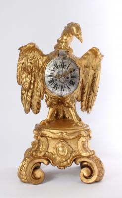 A decorative South German parcel gilt sculptural table clock, circa 1730.