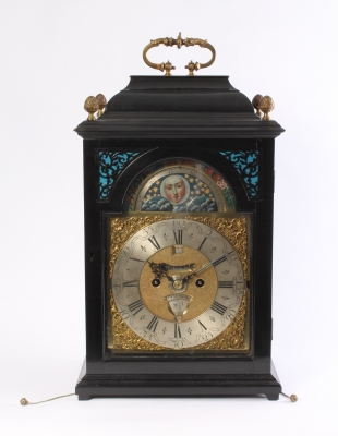 A Dutch ebonised table clock with date, day and moonphase, by J.P. Kroese, circa 1740
