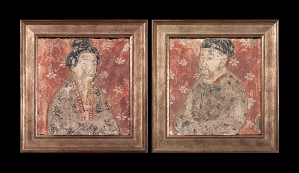 Two Chinese pottery tiles showing a husband and wife