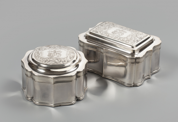 A pair of silver biscuit boxes