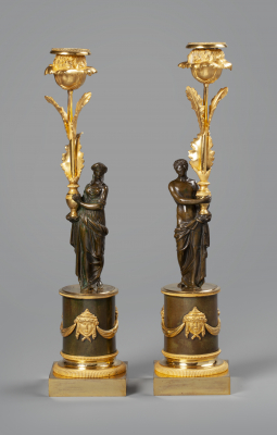 A pair of Empire candlesticks