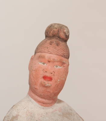 Chinese pottery figure of an official with most of the original pigmentation remaining.