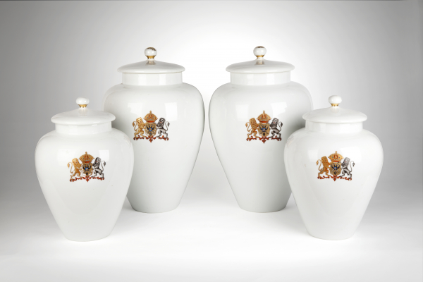 A rare four piece white garniture with a coat of arms of double-headed eagle