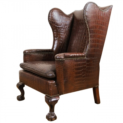 A very unusual and chic crocodile upholstered wing chair.