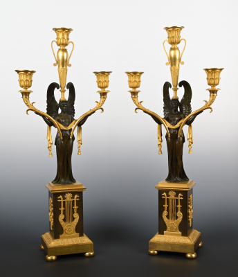 A pair of French fire-gilt and patinated bronze Empire candalabra.