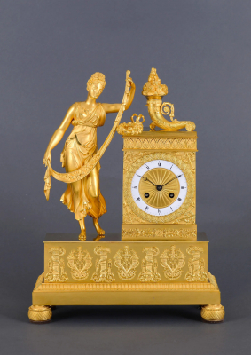 A fire-gilded bronze French Charles X mantel clock De Abundance