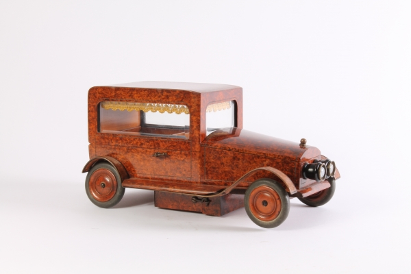 An Art Deco thuja burr model of a car with music box, circa 1930