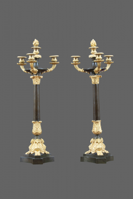 A pair of ormolu and patinated Charles X French four-light candelabres