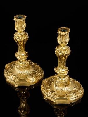 Pair of French Louis XV candlesticks after a design by Juste Aurele  Meissonnier