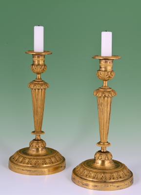 A pair of Louis Seize candle sticks