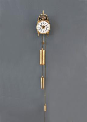 A rare miniature French brass lantern clock with alarm clock, around 1750