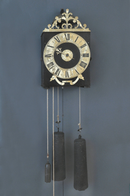 An early French provincial iron and brass Morbier wall clock with brass pointer, 1730