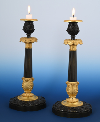 A pair of  ormolu bronze Charles X  candle sticks
