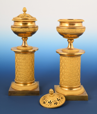 A pair of Empire ormolu potpourri vases