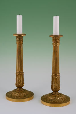 A pair of Empire style candle sticks