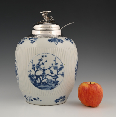 A large Chinese porcelain punchbowl with silver mount.