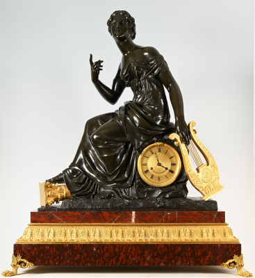 An extremely large bronze French mantel clock