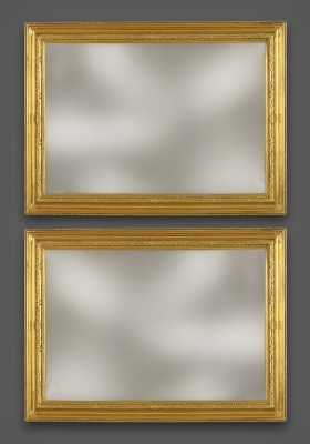 Pair of French bronze Régence Frames
