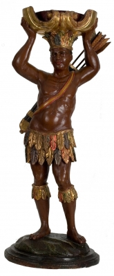 A polychrome and giltwood figural torchere