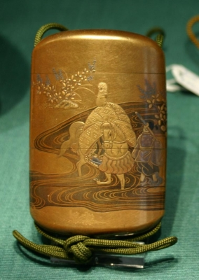 An large inro decorated mainly in gold Japanese Lacquer