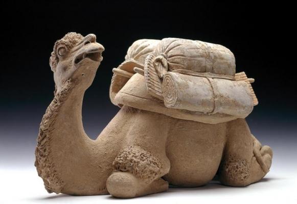 A reclining pottery camel Tang ceramic