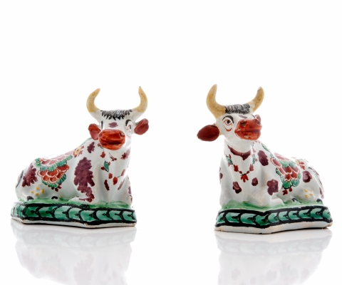 A Pair 'Petit Feu' Recumbing Cows