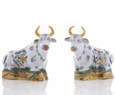A Pair Polychrome Recumbing Cows in Dutch Delftware