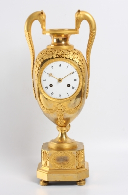 A large French Empire ormolu urn mantel clock with mythical animals, circa 1800