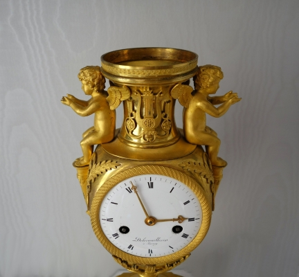 An exceptional cast and modelled Directoire urn-clock, ode to love and music, by Delecoeuillerie à Tournay, ca. 1795.