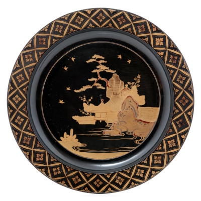 Japanese black lacquer plate with gilt landscape design, late 17th/early 18th c (one of a pair)