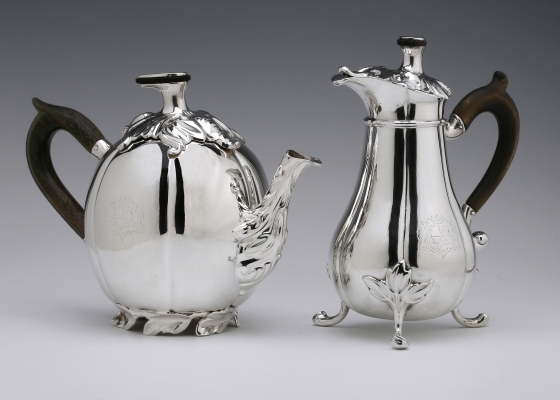 An antique Dutch silver teapot and milk jug