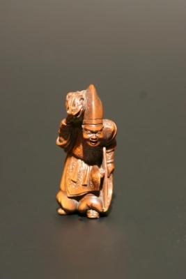 A wooden netsuke: mythological figure