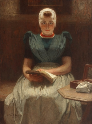 Girl reading in regional attire